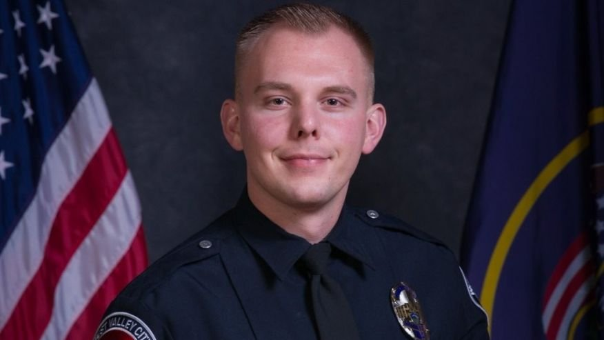 Utah police ID officer fatally struck by car