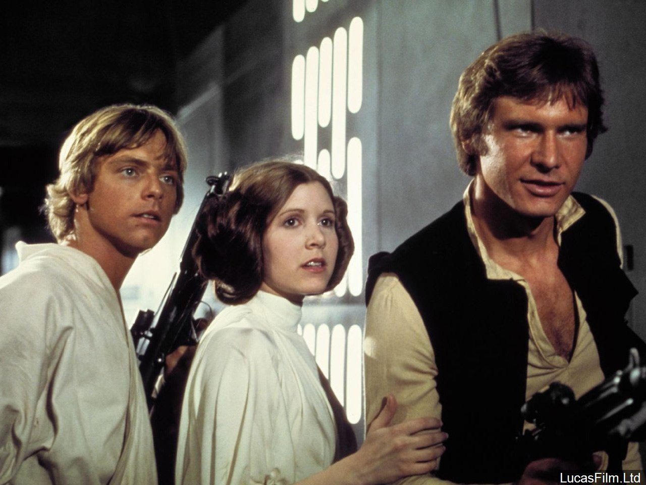 PHOTO: Harrison Ford, Carrie Fisher, and Mark Hamill in Star Wars: Episode IV - A New Hope, Photo Date: 1977