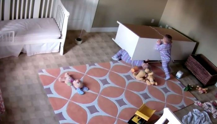 Toddler saves twin brother from being crushed by dresser