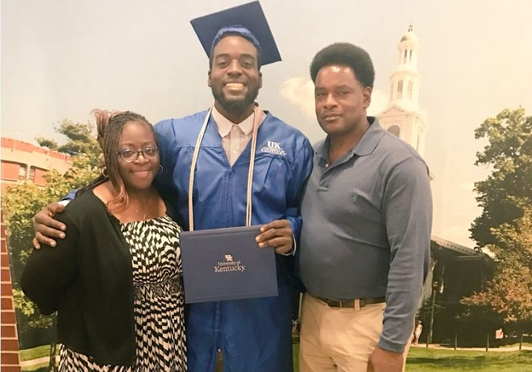 Nick Haynes and his parents after his graduation.