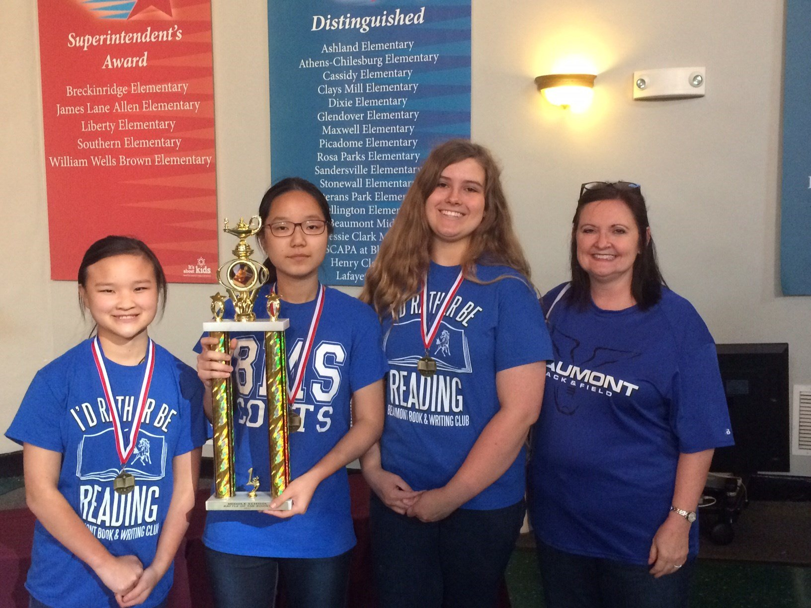 Battle of the Books - Beaumont Middle School and Gardensprings Elementary take home the division trophies