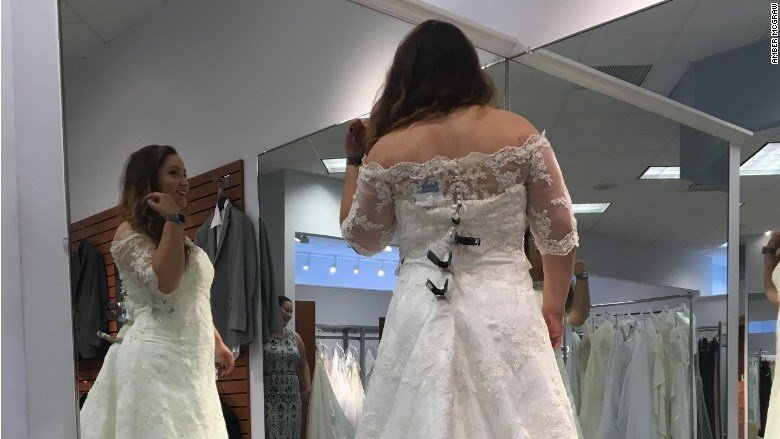 Amber McGraw tries on her Alfred Angelo wedding dress at the Dublin, Ohio location. (CNN)