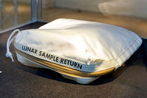 (AP Photo/Richard Drew). The Apollo 11 Contingency Lunar Sample Return Bag used by astronaut Neil Armstrong, to be offered at auction, is displayed at Sotheby's, in New York, Thursday, July 13, 2017.