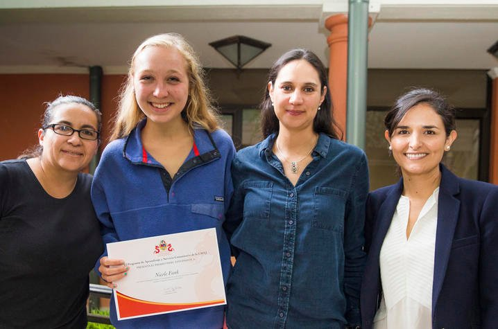 Nicole Funk (second from left) with Universidad San Francisco de Quito faculty and staff.