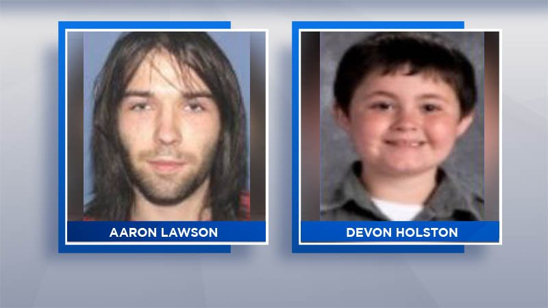 Boy's body found after 3 adults slain; manhunt underway
