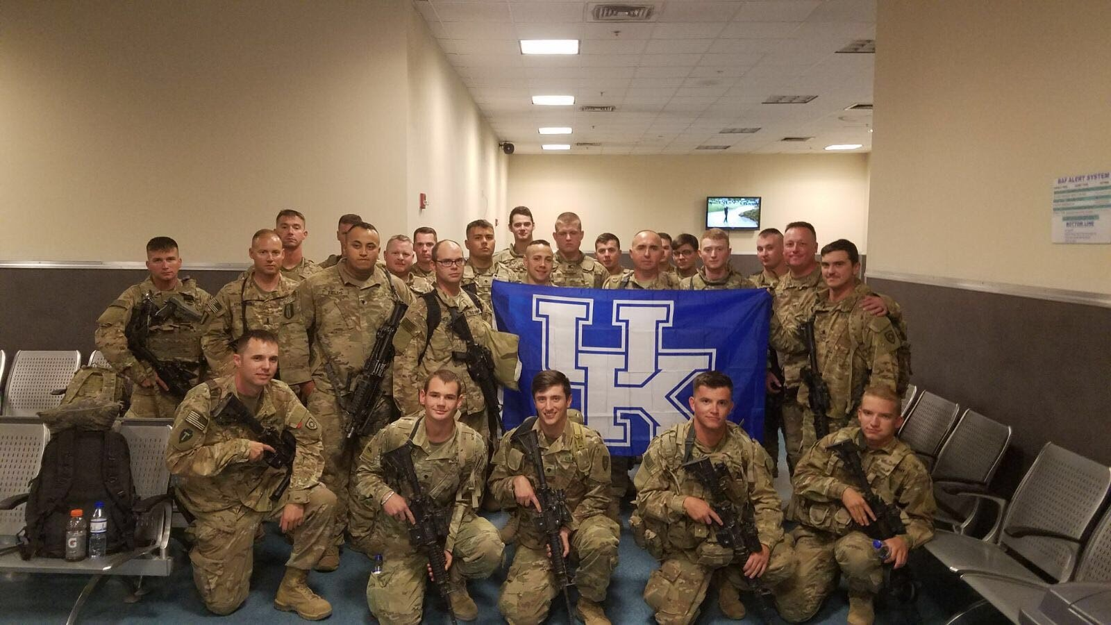 The Kentucky Army National Guard 207th Engineer Company based out of Hazard has this photo taken at 2 a.m. after returning from Kuwait to Afghanistan recently. The UK flag was sent in a care package by a troop member's family.
