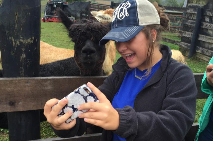 A selfie with an alpaca during Teen Leadership Washington County's Agriculture Day. Photo by Roberta Hunt