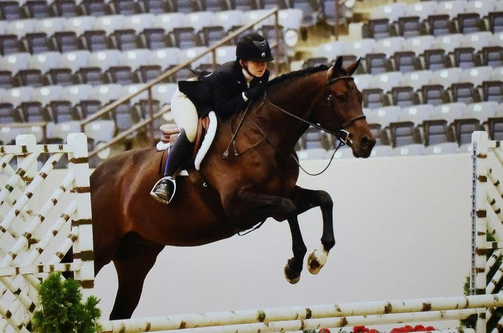 Alexis Johnson and her horse Joey jump in competition