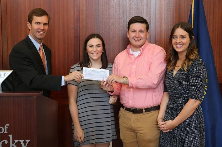Emily Bonistall Postel, right, joined students from her Spring 2017 sociology class as Attorney General Andy Beshear presents the video contest winning check April 28, 2017.