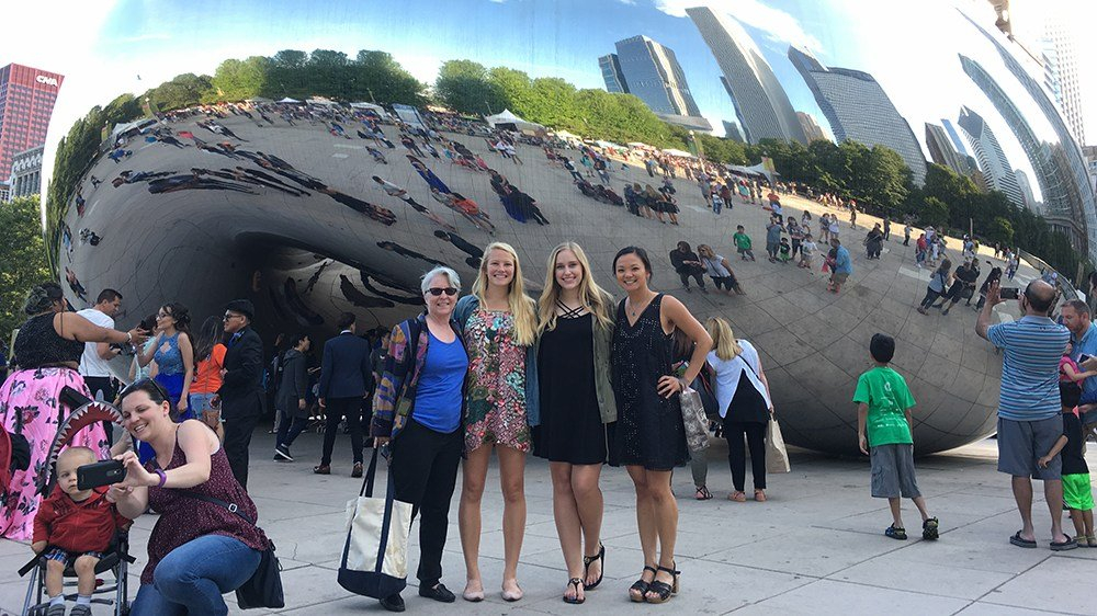"Above: (from left) Mykol Hamilton and students Elayna Seago '17, Bre Olson '19 and Charlotte Sackett '17 at Chicago's Cloud Gate Sculpture, also known as the ""Bean."""