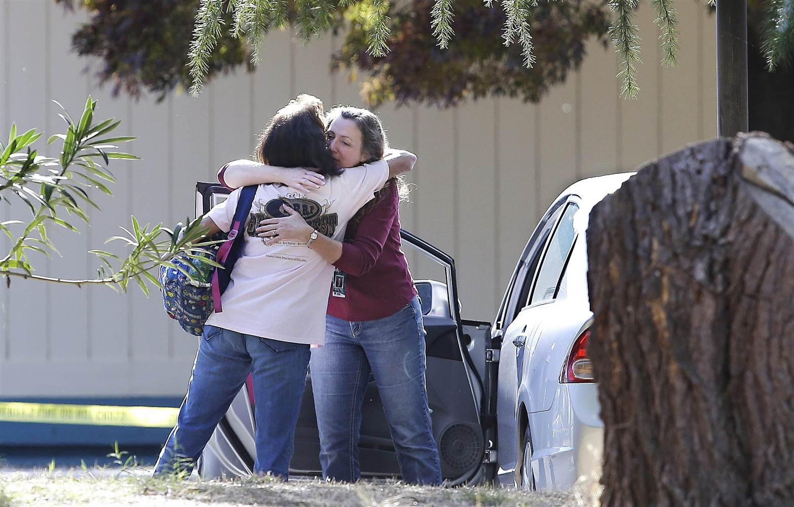 Two women embrace outside Rancho Tehama Elementary School, where a gunman opened fire on Nov. 14, 2017, in Corning, California. Rich Pedroncelli / AP