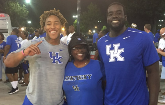 Nick Haynes, right, with his mom and running back Benny Snell after UK's win at South Carolina this season.
