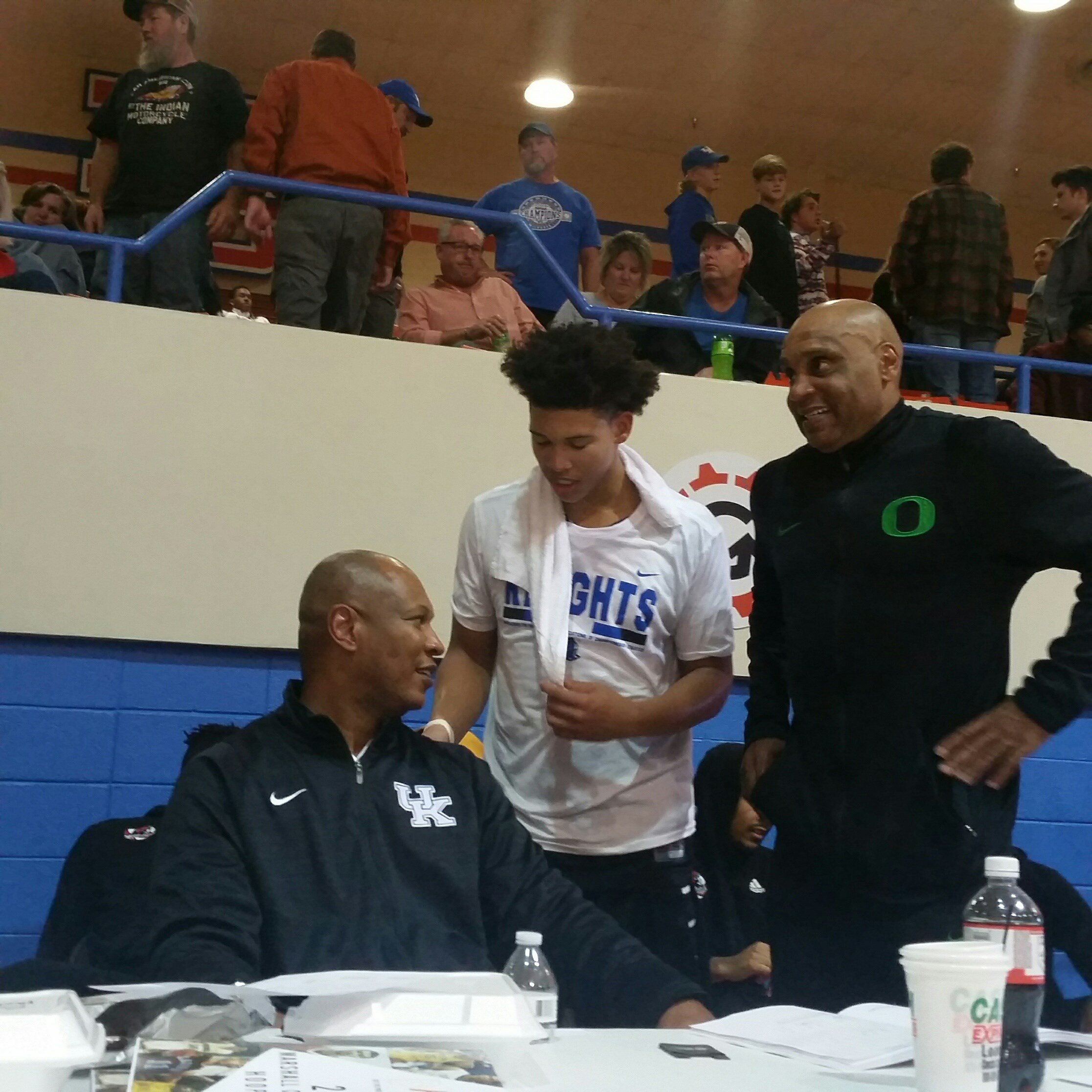 Zan Payne talks with his father, Kenny Payne, after his game at the Marshall County Hoopfest last week. (Larry Vaught Photo)