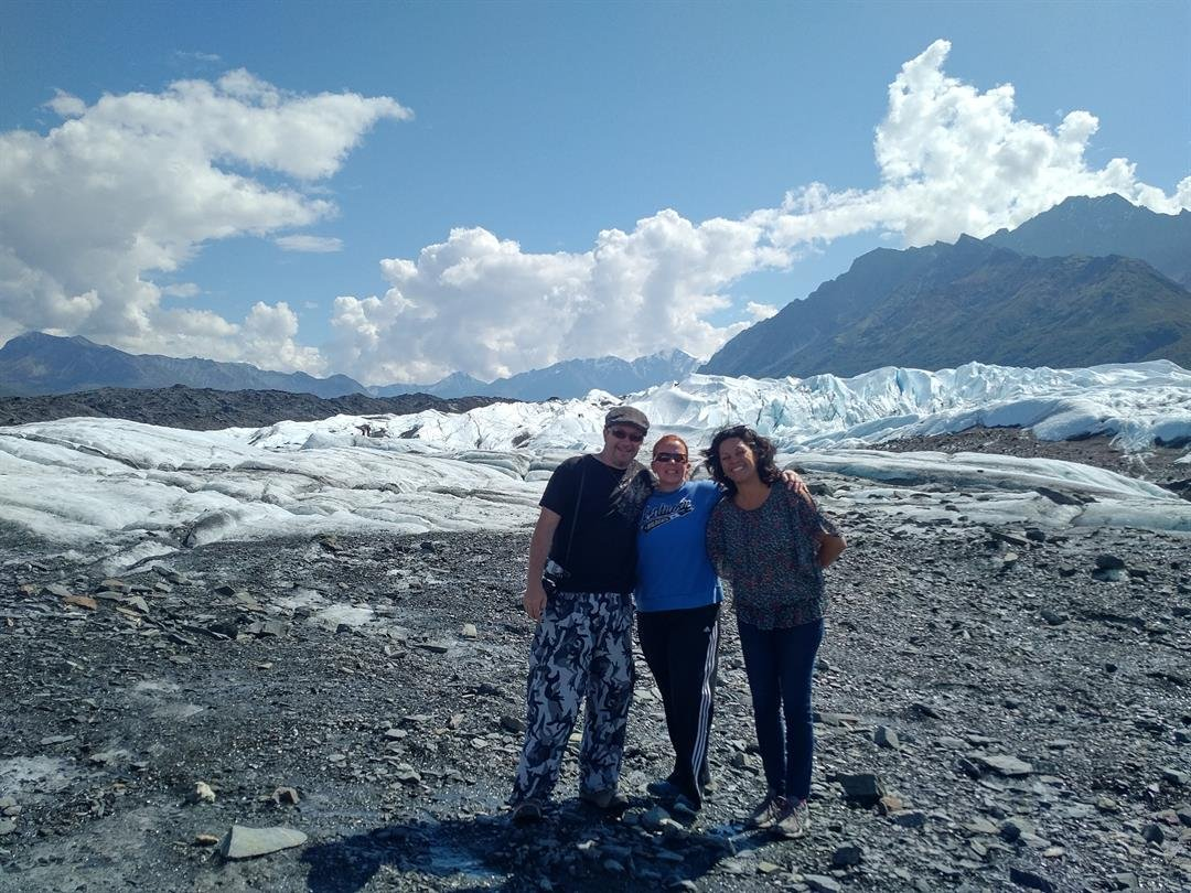 Keri Scaggs at a glacier in Alaska with friends visiting from LA who cannot understand her passion for UK sports.
