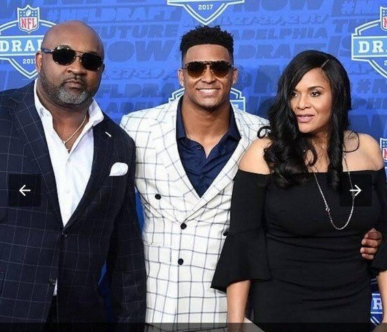 George Adams, left, with his son and wife at the NFL draft where the Jets picked his son in the first round. Adams thinks UK running back Benny Snell will be a good NFL player.